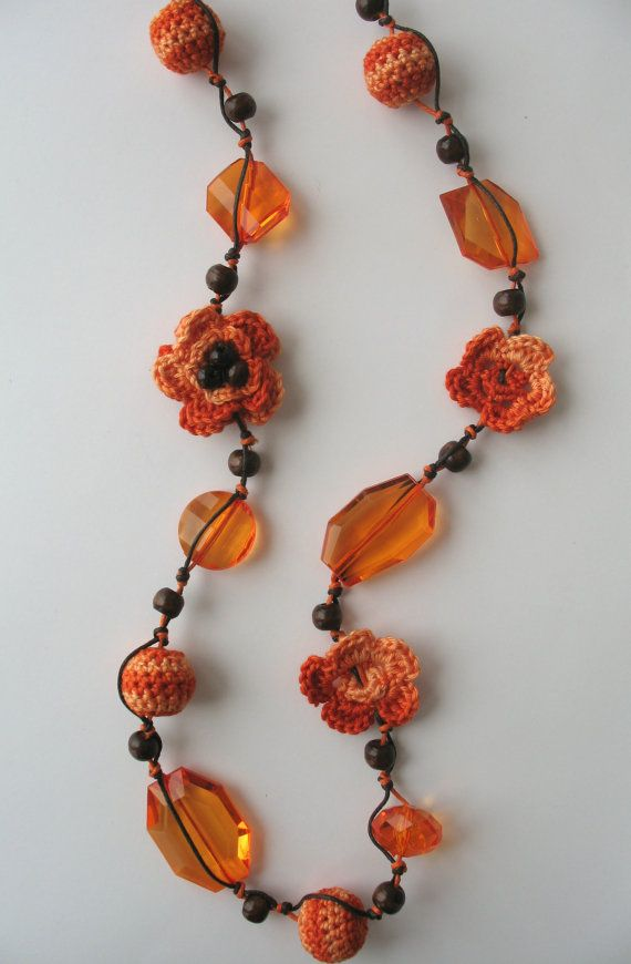 Orange crocheted necklace with beads. $27.00, via Etsy.
