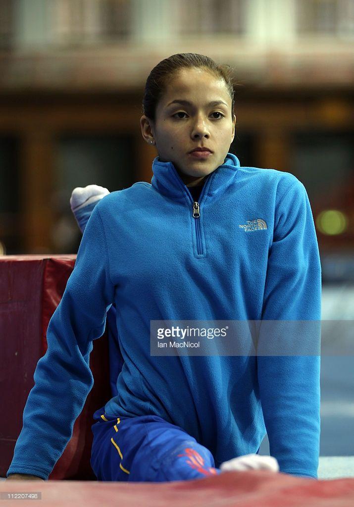 Jessica Lopez of Venezuela stretches during practice prior to the 2011 FIG Gymnastics World