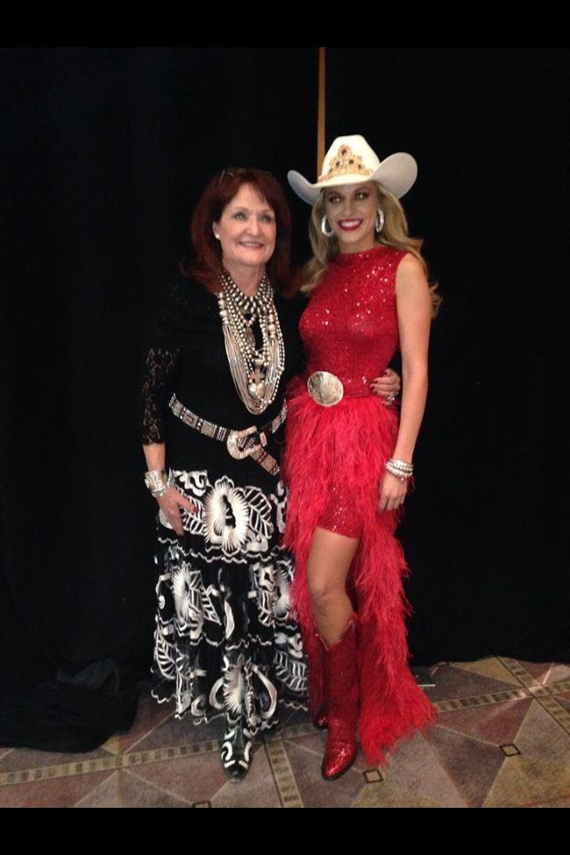 Miss Rodeo America 2013 Chenae Shiner in a Red Sequin and feather dress at the fashion show