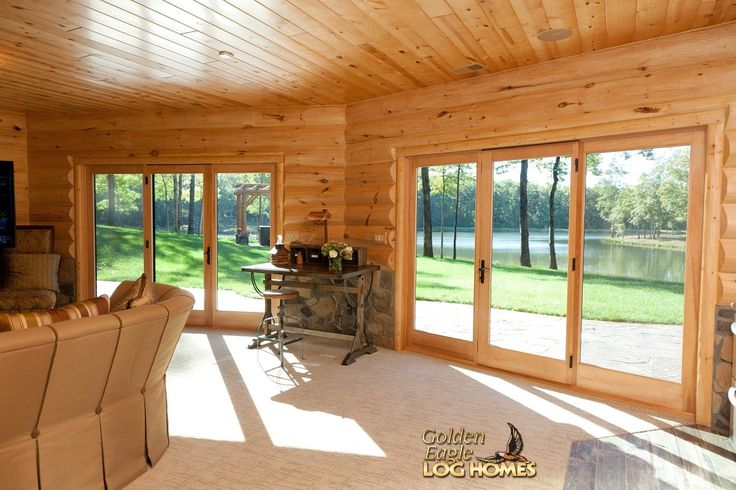 log home by golden eagle log homes finished basement walkout wall