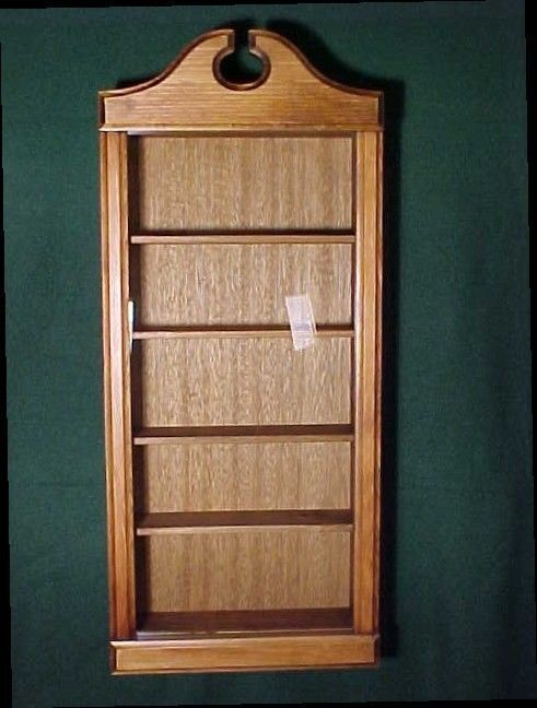 """WALL CURIO CABINET. Glass door is 28 1/2""""h,12"""" w. Made of pine with walnut finish. The back, box part, of the cabinet is 24""""h, 12""""w and 3"""" deep. Inside height is 22 1/2"""", wall to wall width is 10 1/2"""".   eBay!"""