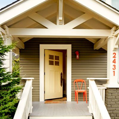 1918 craftsman bungalow after remodel entryway with orange house number and chair