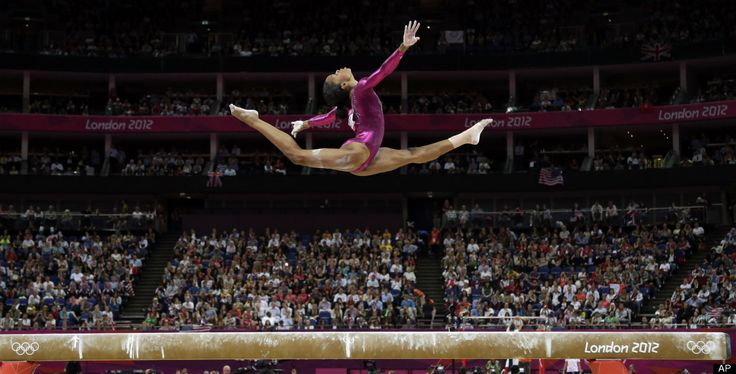 U.S. gymnast Gabrielle Douglas performs on the balance beam during the artistic gymnastics women's individual all-around competition at the 2012 Summer Olympics, Thursday, Aug. 2, 2012, in London. Gabrielle Douglas