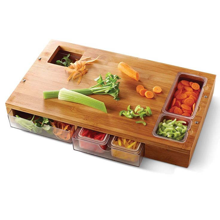 The Sous Chef Prep Station - Hammacher Schlemmer- Designed by a chef with 20 years of experience cooking at restaurants worldwide, it combines a cutting board, a garbage chute, and built-in containers for holding prepped ingredients.