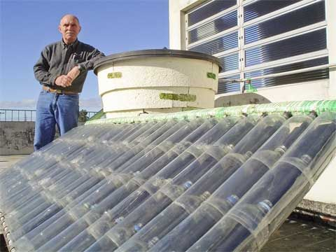 How to make a difference - Cliimate Change and energy - How to make a solar water heater from plastic bottles - award winning system. The Ecologist | Links to PDF DIY instruction guide. Needs translation from Portuguese.