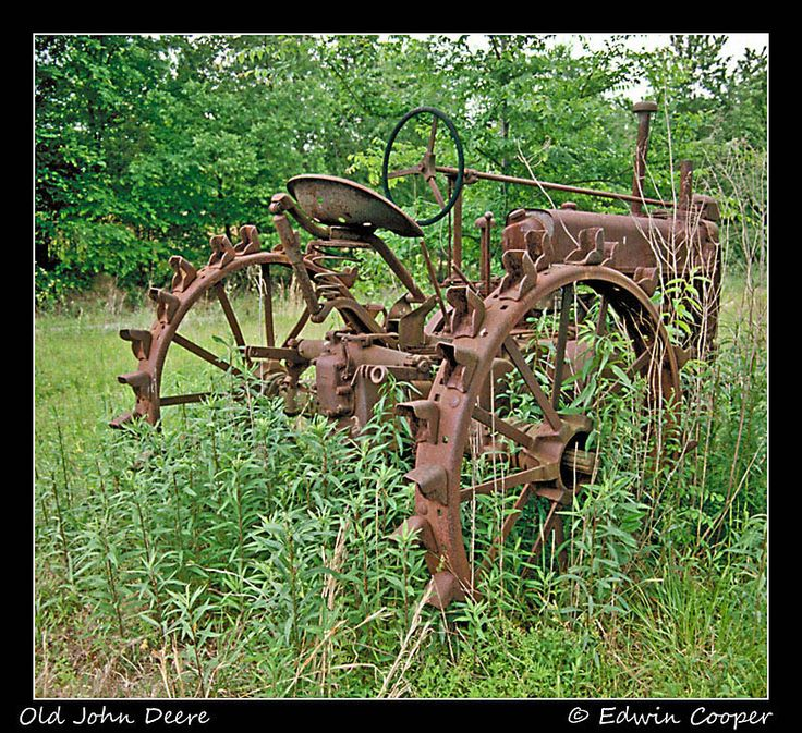 Old John Deere.  I love old rusty things of the past.  Wish I had this, it would bring such ambiance to the back garden.