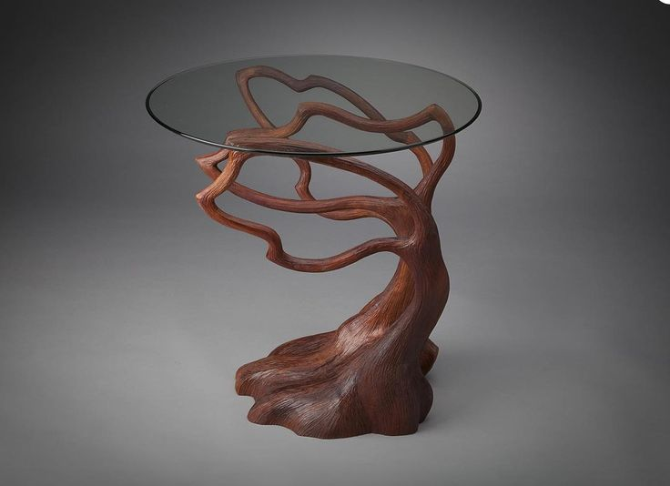 Inspired by woodlands Aaron aims to bring natural shapes inside using organic materials and forms. This unique table available at Artful Home is constructed from hand-carved laminated cherry wood. Its delicate balance mirrors nature's ever-changing landscape.  To see more work by Aaron Laux Design visit http://ift.tt/2qqPKmN  #AaronLauxDesign #woodsculpture #wooddesign #woodcarving #wooddecor #woodwork #madisonmaker #madisonartist #madisonart #handmadedecor #customtable #handmadefurniture…