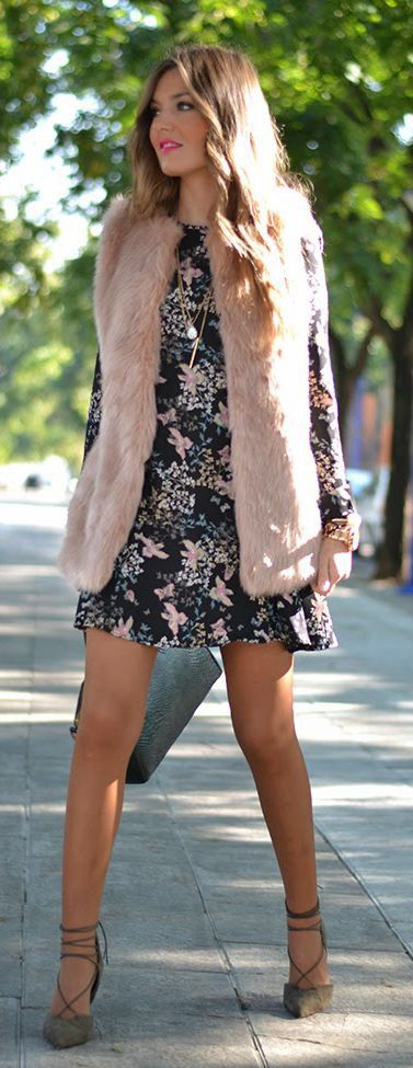 Floral dress & pink fur vest.