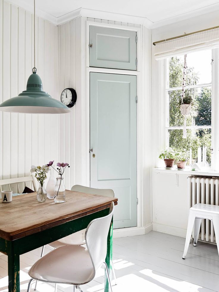 Minimalistic kitchen space with a twist of mint green #scandinavianhome #interiorinspiration