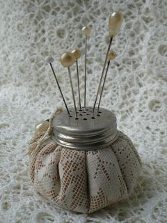 Pincushion using the cover from an old salt cellar, vintage lace and filled with bird gravel or crushed walnut shells.