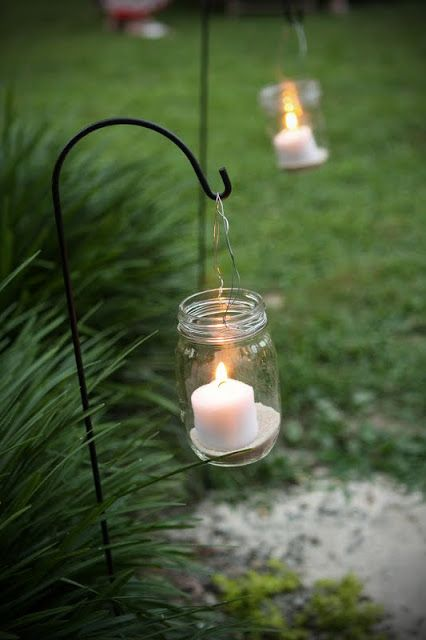 Easy way to light a path at a party! Use Candle Impressions Flameless Candles in case someone bumps into the glass