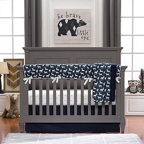 Create a modern yet rustic nursery with Liz and Roo's Woodland Crib Bedding. This 3-Piece Crib Bedding Set features arrows and deer, in classic neutral navy and white, and includes a reversible faux fur blanket, a crib skirt, and a fitted sheet.