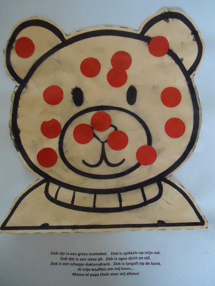 Kiki heeft de waterpokken.  Print het hoofd van Kiki op bruin gekleurd papier. Maak rode rondjes van papier en laat ze op het hoofd van Kiki plakken.