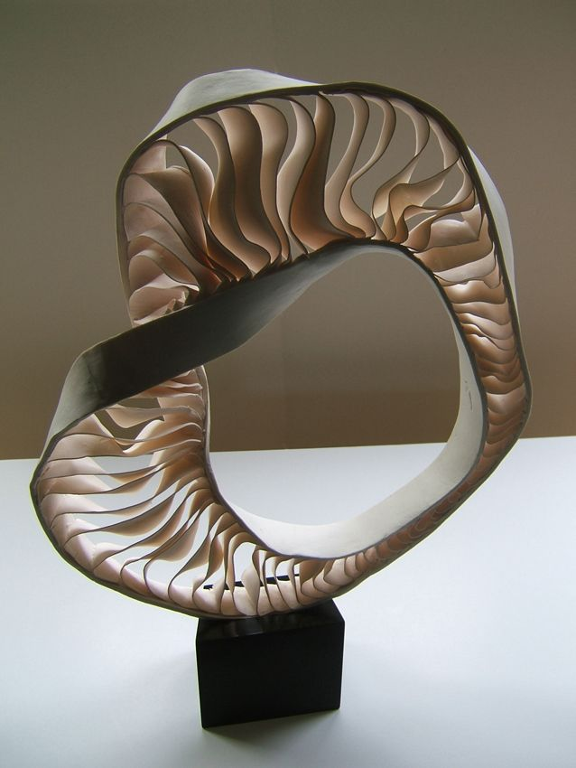 Fenella Elms - Ceramics Artist - Sculpture...I love how she curved the shape and showing beautiful form of clay design, the texture and colors are perfect.