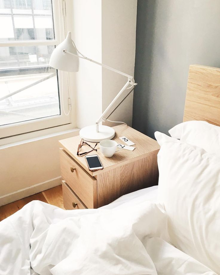 minimal white bedroom in Paris apartment by instagram.com/larisazz
