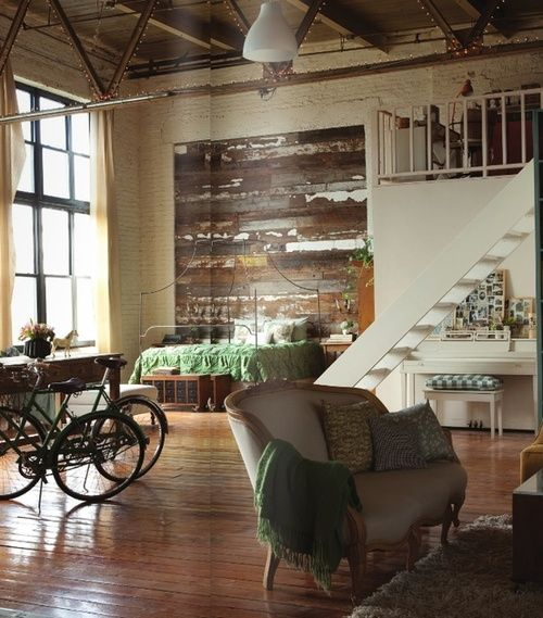 Loft Open Concept Living Space With Bedroom And Weathered Wood Wall Accent