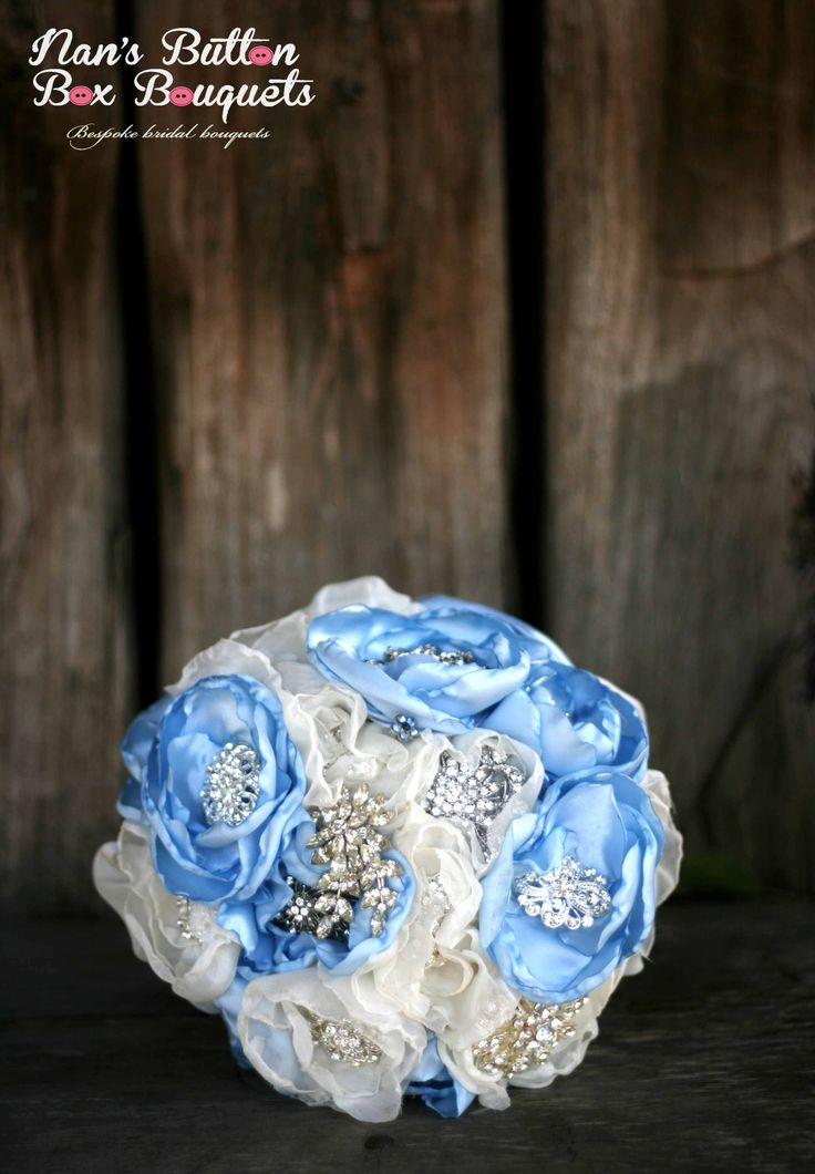 Something old, something new, something borrowed, something blue. We loved making this bouquet! it includes a few of our nan's vintage brooches.