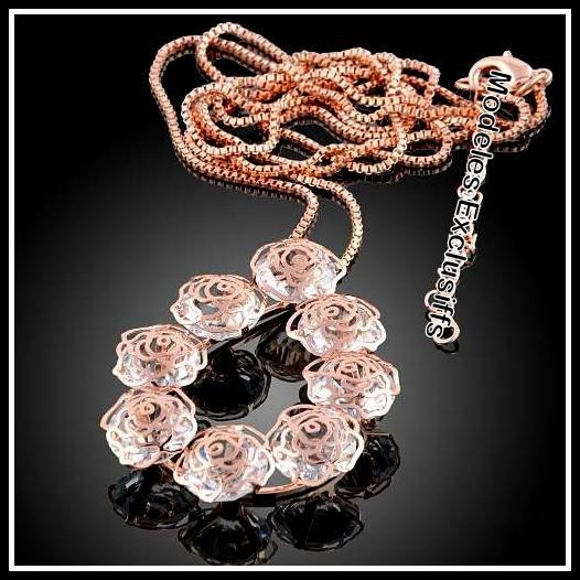 18K Rose gold 9 rose crystal pendant on a long sweater chain.
