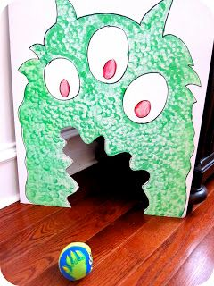 Feed the monster game. Bean bag toss.  This website is more toddler friendly.