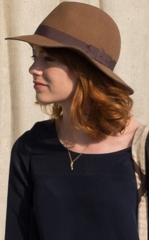 Hot off the heels of ditching her blond locks for a ravishing new red 'do, Emma Stone has chopped her mid-length hair into a trendy long bob. #hair