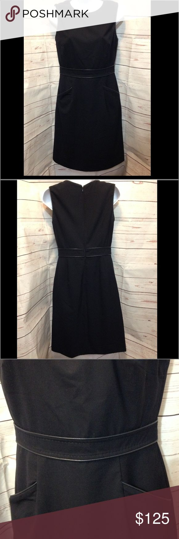 """Tory Burch navy blue dress Tory Burch navy blue dress.  Gorgeous, fully lined navy blue sheath dress.  Two front pockets and leather trim around waist, arms, neckline and pockets.  Full zip up back with hook & eye closure.  37.5"""" long, 15.5"""" across chest, 13.5"""" at waist.  Excellent condition! Tory Burch Dresses Midi"""