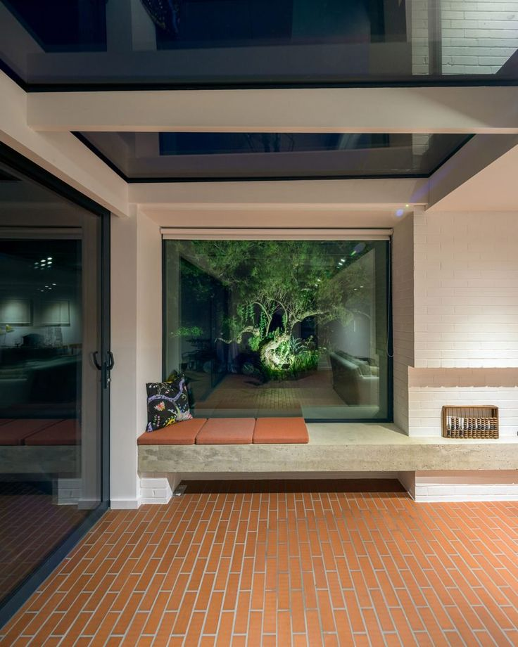 An additional 20-square-metre conservatory was also permitted, so the studio extended the main living area into a glass-walled volume that frames views of the garden