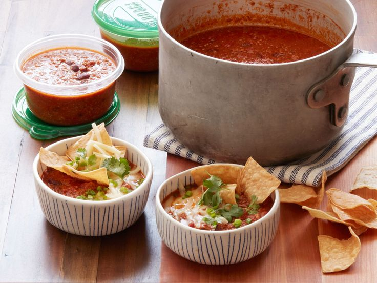 Big-Batch Turkey Chili : You'll want to pull out your biggest pot to make a hefty batch of Food Network Kitchen's easy turkey chili.To reheat, let the chili thaw in the refrigerator overnight, then let it simmer on the stove until it's heated through. You can thin it with a little water, and add salt to taste.