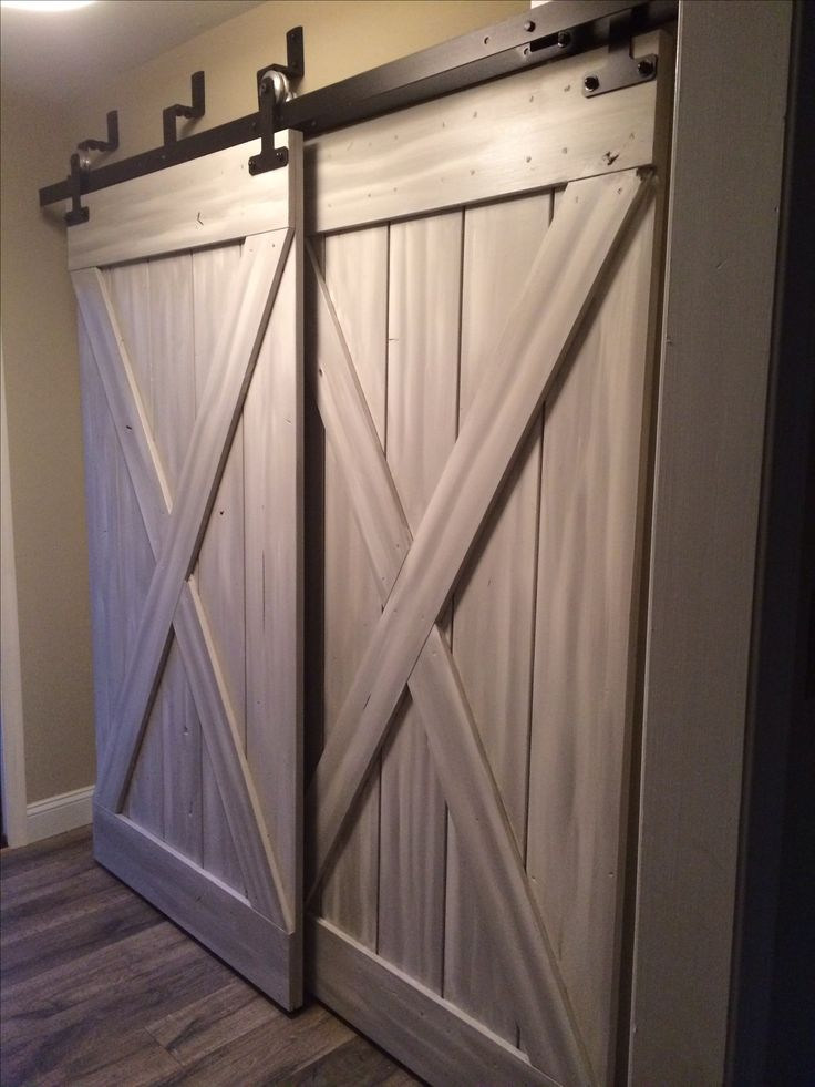 Bypass sliding barn doors in mudroom for the home for Bedroom closet barn doors