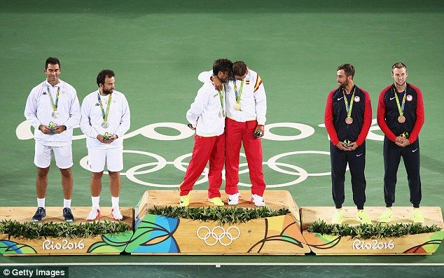 Silver medallists Horia Tecau and Florin Mergea of Romania (left) look on from…