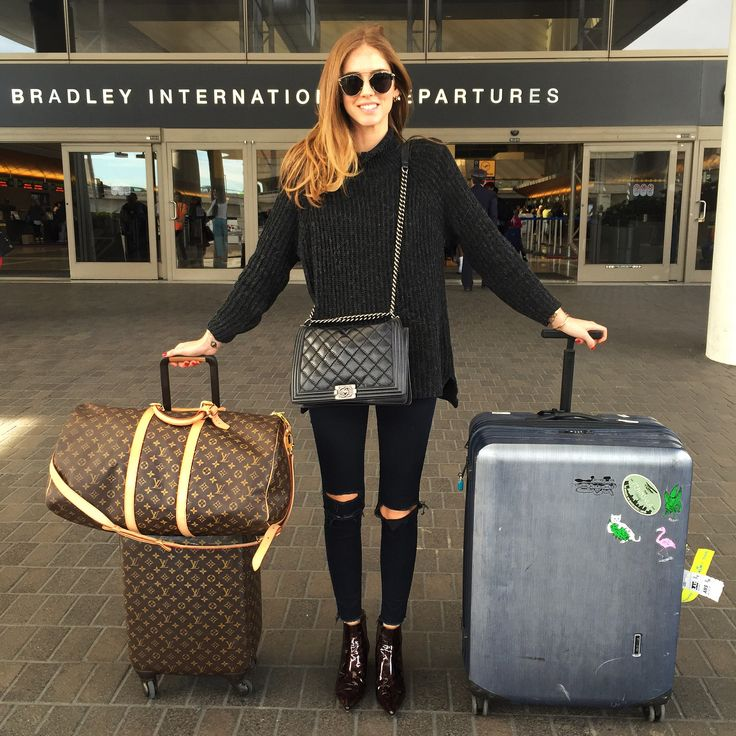 Chiara Ferragni Her beat up suitcase looks more interesting than the LV. Great travel look.