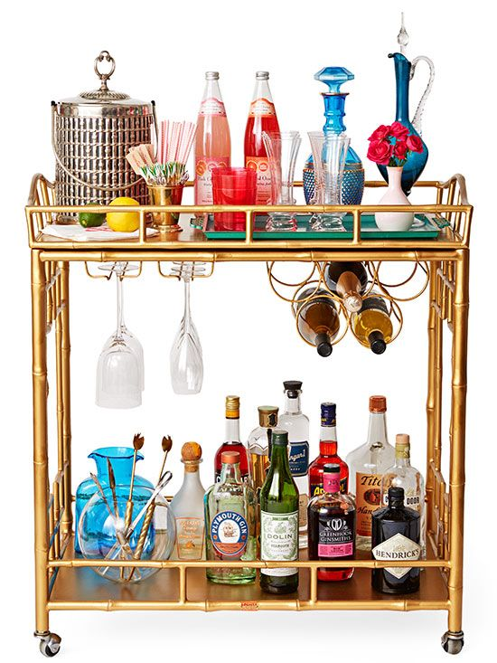 Cheers all Eve-ning long with a well-stocked (and well-dressed) bar cart! http://www.bhg.com/holidays/new-years/recipes/new-years-cocktail-party/?socsrc=bhgpin121214stockabarcart&page=2