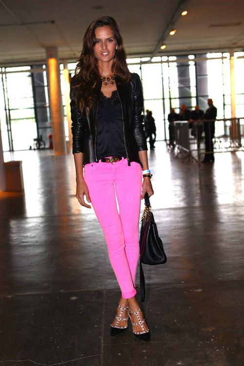 la modella mafia Model Off Duty street style - Izabel Goulart in neon hot pink skinny cuffed jeans with studded Valentino heels