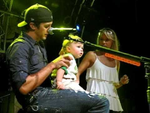 Luke Bryan trying to get Bo to dance at the Nuthouse Fan Club Party