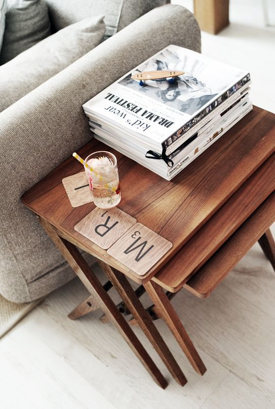 #three vintage tables # a dragon cup # few magazines # kid's wear on top # scrabble #mr.J #straw #couch photography: thecoolheads.com