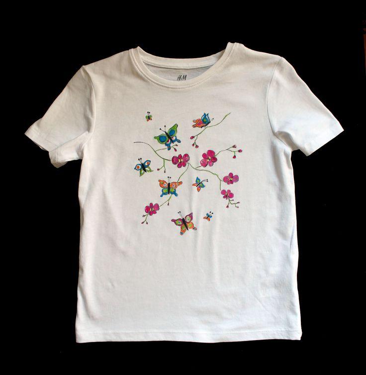 Camiseta mariposas con orquídeas.