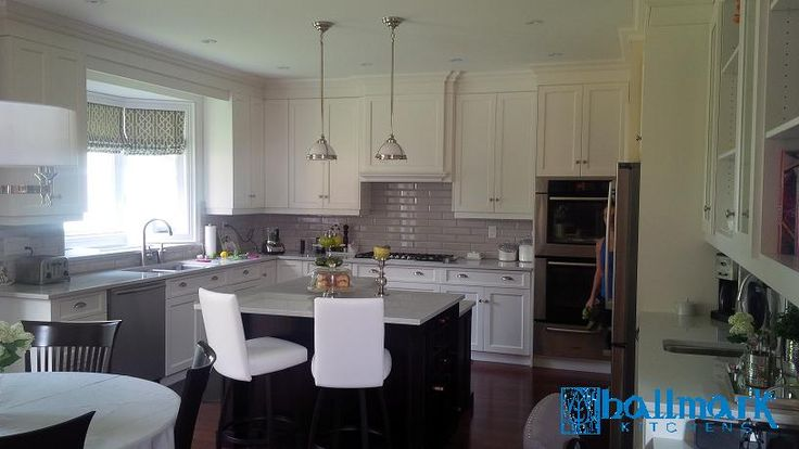 Cloud White MDF cabinets with stained Birch island