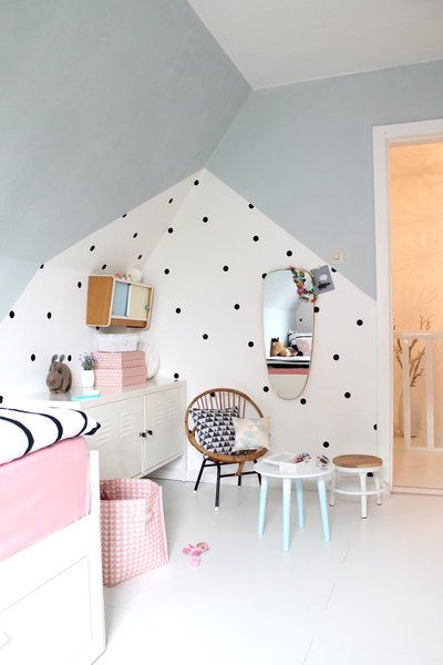 Fun pink and grey-blue kids room with an eye catching wall feature with geometric shapes and dots