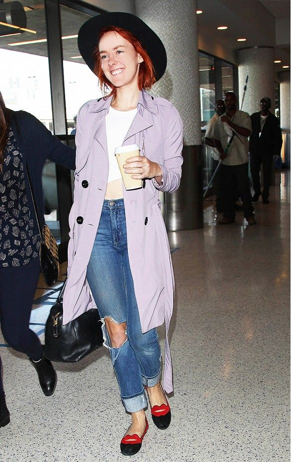 Jena Malone was pretty in pastel at LAX in a lavender coat, distressed boyfriend jeans, embellished loafers, and a wide-brim hat.