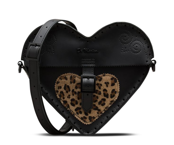 A heart-shaped satchel, designed to bring a smile to even the blackest of hearts, with a removable strap, zip fastening, brogue detailing and a faux ponyskin leopard print panel. Detachable, adjustable strap Brogue detailing Made with Smooth leather plus Italian hair-on leather in a faux leopard print Secure buckle fastening Dimensions: 10 inches Long x 8 inches High x 3 inches Deep