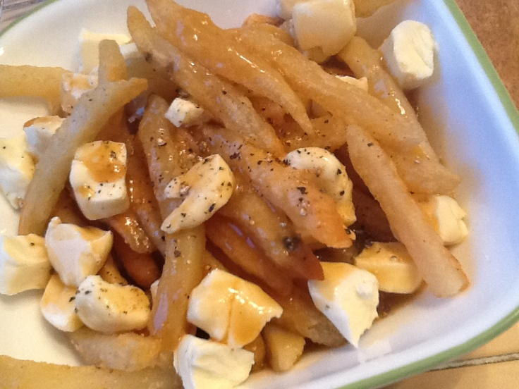 Homemade POUTINE! Delish, crispy oven fries, topped with a nice gravy and topped with Gouda cheese curds! Heaven in a bowl :)
