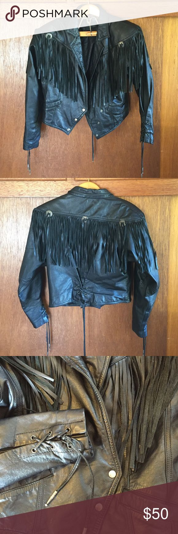 Genuine Leather Fringe Motorcycle Jacket So you're a biker. Or an aspiring biker. You must be if you're checking out this leather jacket made for motorcycles, right? If you're not afraid of turning heads, feeling like the queen of the road, and giving off a slightly dangerous vibe, this jacket is for you. Complete with long fridge, silver beads, a three-snap asymmetrical front closure, and laced closures on the sleeves and the back. Strike fear and awe in the heart of common motorists. It's…