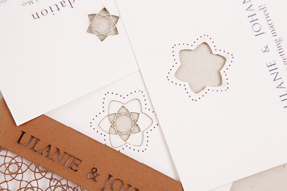 Chrystalace Wedding Stationery Autumn inspired invitation with intricate laser cutting.