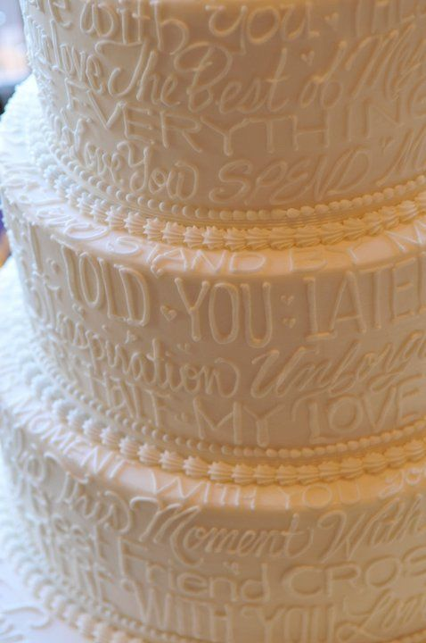 Vows or song lyrics on the cake. Great idea!!