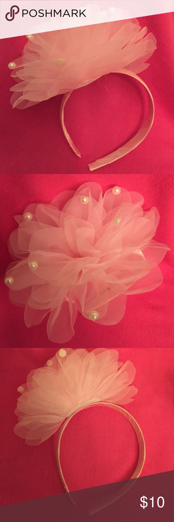 Pink with Pearls Headband So Girly Pale Pink Headband. Solid Pale Pink Band with Tulle Fabric shaped into Petals. Fabric is adorned with Large Faux Pearls. Your daughter will be Pretty in Pink!  Brand New Excellent Condition. No Trades. OMG! Accessories Hair Accessories