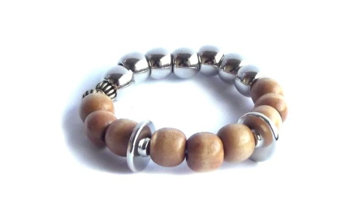 Silver and varnished wood bracelet. Elastic.   For price visit website.