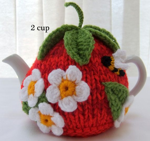 Lovely hand knitted 2 cup tomato tea cosy. The main body of this tea cosy is knitted in triple dk multi red toned acrylic wool with a green stalk and leaves on the top, embellished with crochet/knitted tomato blossom, leaves,a bumble bee and butterfly , suitable for a two cup tea pot (tea pot not included, for display purposes only) Please refer to my polices to view my teapot size table to ensure that the correct size of cosy is purchased.