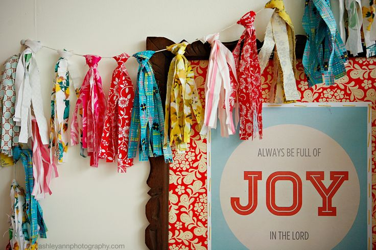 Okay...so this look's like a repeat of a post from last week, but I assure you it is not.After I hung my sister's print, it just didn't look right. I wasn't crazy about the bunting so I decided to make something new.A scrap fabric garland. That is the most creative name I could come up…