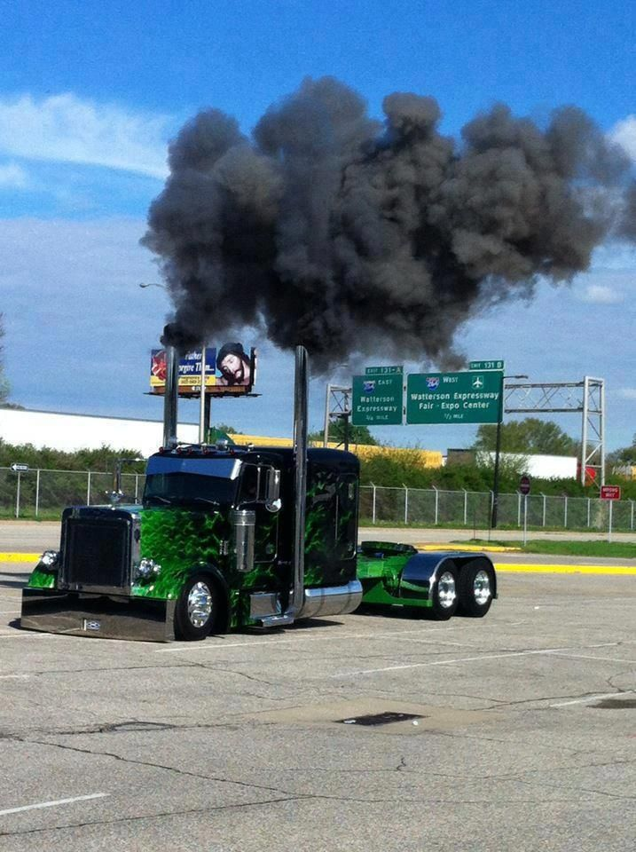 Green real flame on black Peterbilt rollin' coal