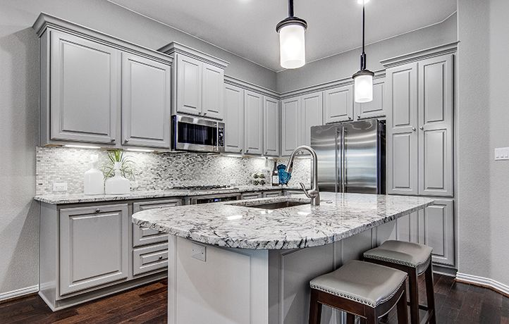 Luxury Kitchens in our Village Builders Austin Homes. Find your Dream Home during our Moonlight Madness Sales Event. Up to $30,000 off select homes!*