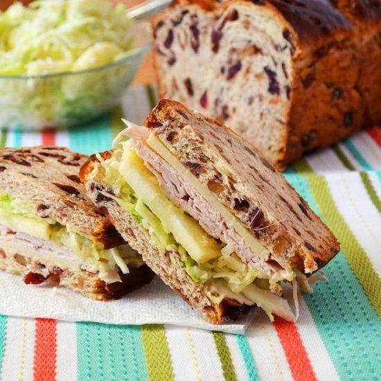 A copycat recipe of Panera's Turkey, Apple, and Cheddar Sandwich on Cranberry-Walnut bread.